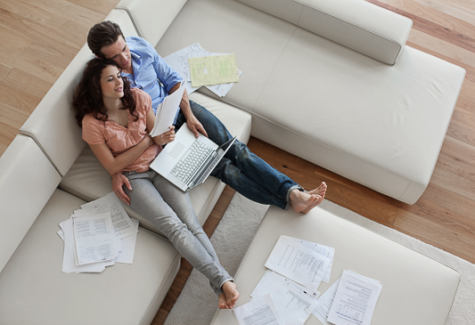 This image shows a couple having conversations about money and their financial future.