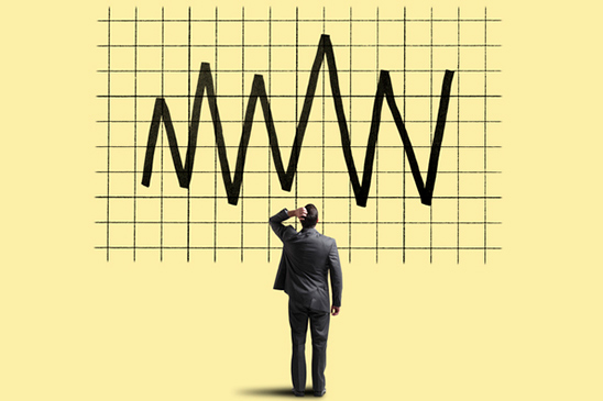 This illustration shows a man trying to understand why financial markets are rising and falling during COVID-19.